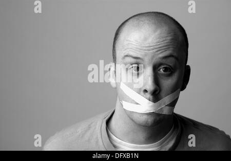 Humor, mouth taped close - Stock Photo