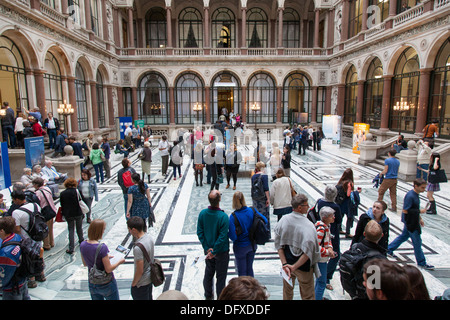 Visitors walk around the Durbar Court designed by Matthew Digby Wyatt within the Foreign and Commonwealth Office, - Stock Photo