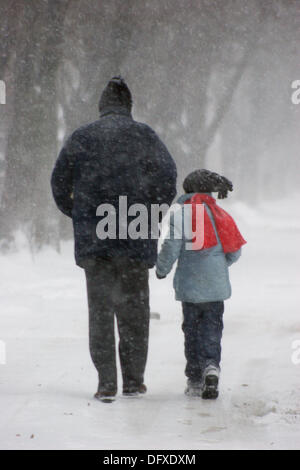 Father and son walking through the blizzard - Ferentari neighborhood, Bucharest, Romania - Stock Photo