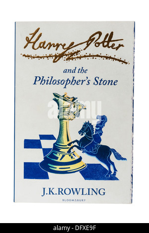 A J.K.Rowling childrens book called Harry Potter and the Philosopher's Stone on a white background - Stock Photo