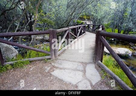 Bridge over the river Manzanares in La Pedriza Regional Park Cuenca Alta del Manzanares Madrid Spain - Stock Photo