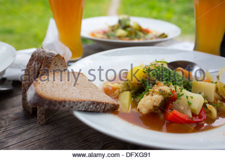 Breads served with vegetable soup and beer, Berchtesgaden National Park, Berchtesgadener Land, Bavaria, Germany - Stock Photo