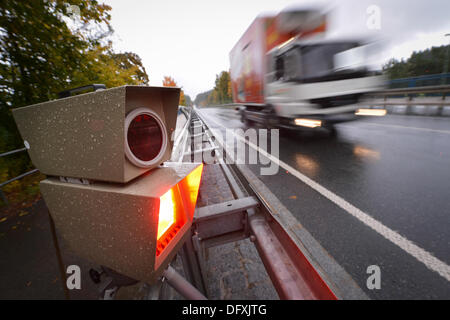 Hinterzarten, Germany. 10th Oct, 2013. A police speed detector flashes on the B31 in the rain near Hinterzarten, - Stock Photo