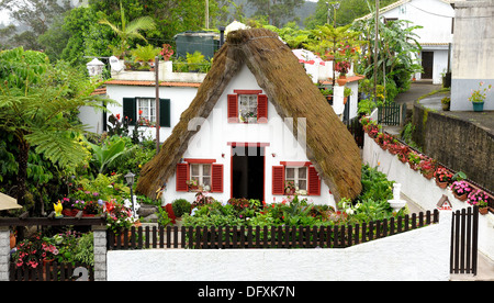 Traditional Palheiro A frame house Santana Madeira Portugal - Stock Photo