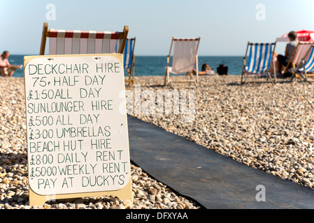 Deckchair hire on the beach at Beer, Devon, England, UK. - Stock Photo