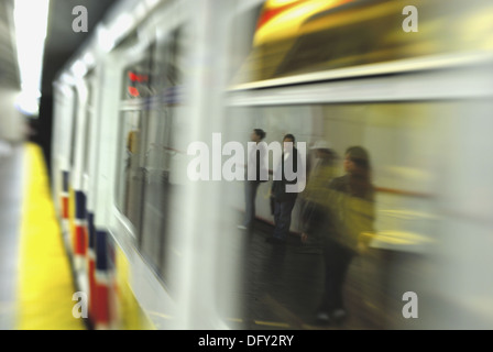 passengers reflected in window of moving skytrain - Stock Photo