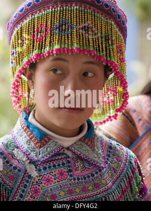 Flower Hmong gal in special ceremony garb. Bac Ha, Northern Vietnam (april, 2006) - Stock Photo