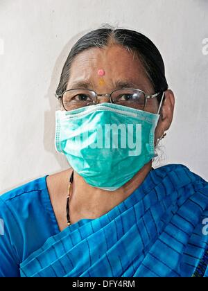 Adult Woman, Precaution mask for Swine Flu, H1N1 - Stock Photo