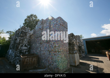 crushed and compacted cubes of metal and aluminum cans at a scrap metal recycling plant in Texas - Stock Photo