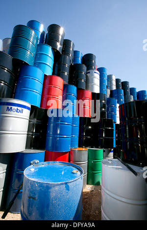 Metal oil barrels brought into scrap metal recycling yard in Texas - Stock Photo