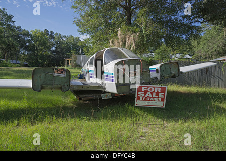 Airplane missing a few parts is for sale in small town in North Florida. - Stock Photo