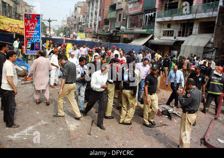 Police, rescues officials and people busy in rescue work at the site after strong bomb explosion outside a Biryani - Stock Photo