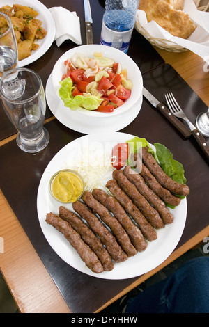 Food display on the table at one of the restaurants in Brasov, Romania - Stock Photo