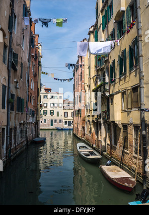 Quiet canal in Venice with wash hanging out to dry - Stock Photo