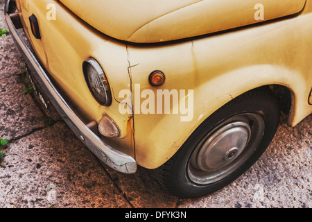 Partial view of of the front of an old Fiat Nuova 500 (built from 1957-1977) in the streets of Rome, Lazio, Italy, - Stock Photo