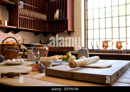 Rustic country style kitchen with cooking utensils. - Stock Photo