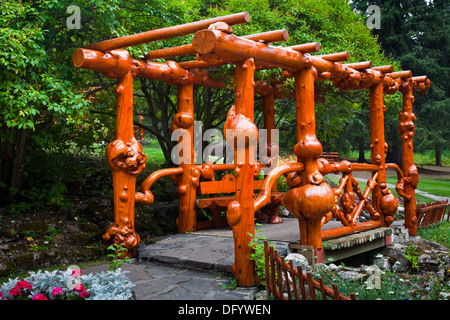 Decorative footbridge constructed from burled trees, Banff, Alberta - Stock Photo