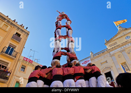 'Castellers' building human tower, a Catalan tradition. - Stock Photo