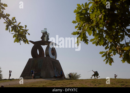 Pilgrims in Monte del Gozo. And monument dedicated to the visit of pope john paul II. Coruña province.Spain. Camino - Stock Photo