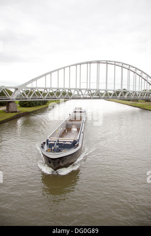 empty transport ship in canal in holland - Stock Photo
