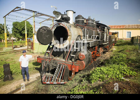 Touristic train going to the estate of Manaca Iznaga, where there used to be big extensions of sugar cane worked - Stock Photo