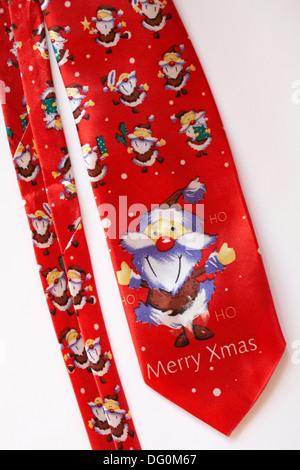 Ho ho ho Merry Xmas Santa Christmas novelty tie set on white background - Stock Photo