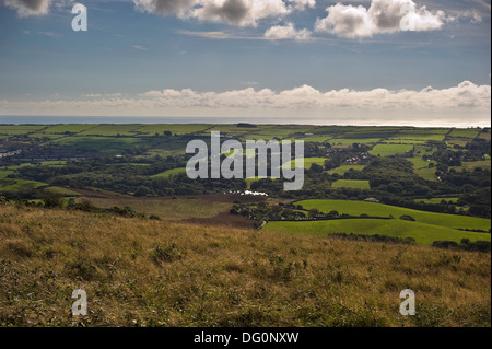 View over the Purbeck Hills with a steam train of the Swanage Railway passing by in the distance. - Stock Photo
