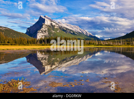 Mount Rundle rising above Banff township from Vermillion lakes drive Banff National park Canada North America Alberta - Stock Photo