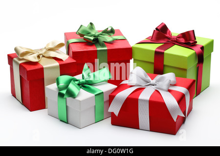 Bright gifts with bows on white background - Stock Photo