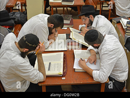 4 religious Jewish students studying Talmud at Lubavitch headquarters in Crown Heights, Brooklyn, New York - Stock Photo