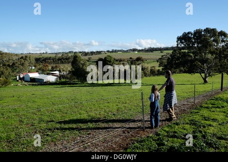Father & daughter overlooking properties in the Clare Valley, South Australia - Stock Photo