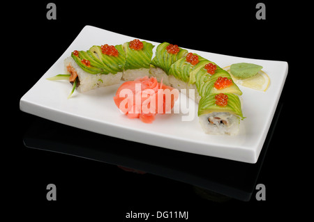 Rolls with avocado and fish looking as a snail - Stock Photo