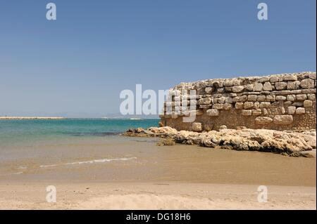 ancient jetty ruins from the Hellenistic period, beach of Sant Marti d´Empuries Costa Brava, Catalonia, Spain, Europe - Stock Photo