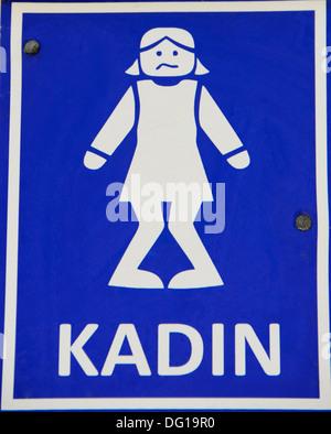 Humorous 'Ladies' lavatory sign, (Turkish) - Stock Photo