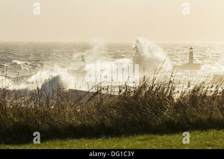 Waves crashing over harbour wall at Seaham, County Durham on the north east coast of England, United Kingdom - Stock Photo