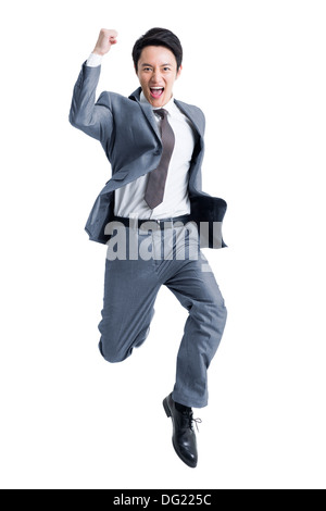 Excited businessman jumping - Stock Photo