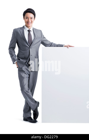 Young businessman with whiteboard - Stock Photo