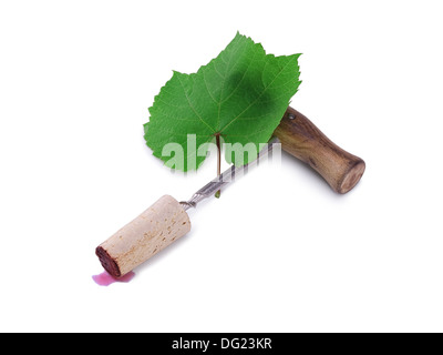 vintage corkscrew and green grape leaf isolated on white background - Stock Photo