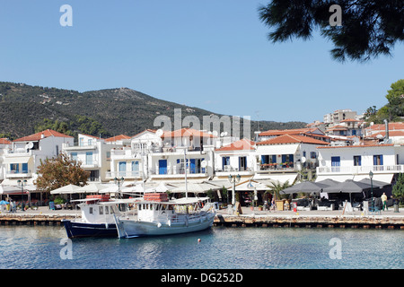 Boats moored in the old harbor in Skiathos Town on the Greek Island of Skiathos, a popular tourist destination in - Stock Photo