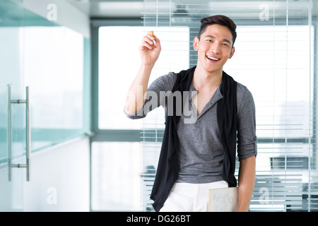 Young businessman in the office - Stock Photo