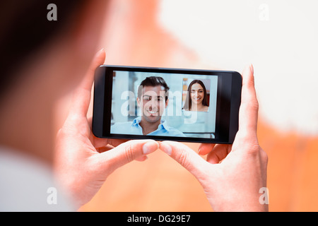 Woman cell phone indoor finger at home - Stock Photo