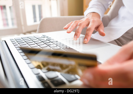 Female laptop finger table desk indoor - Stock Photo