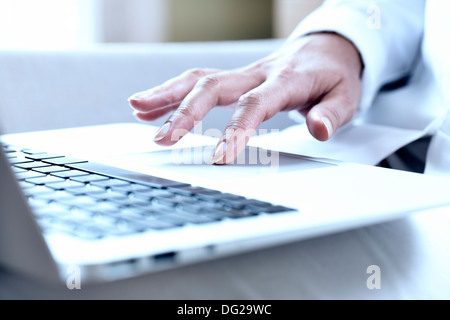 woman computer finger keyboard desk - Stock Photo