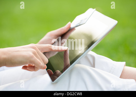 Female outdoor computer finger web plastic card - Stock Photo