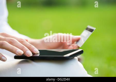 Female outdoor computer finger web plastic card - Stock Photo