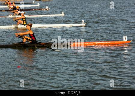 single women's rowing regatta start of the race - Stock Photo