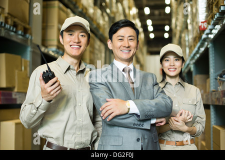 Young logistics team in warehouse - Stock Photo