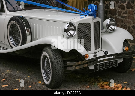 White Bentley Beauford motor vehicle, registration WED 55S, decorated with blue ribbon - Stock Photo