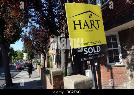 London, Great Britain. 16th Sep, 2013. 'Sold' is written on a real estate sign outside of a home in London, Great - Stock Photo