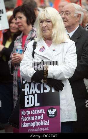 Liverpool, England, UK. Saturday 12th October 2013. Woman at rally. Around 7000 people marched through Liverpool - Stock Photo